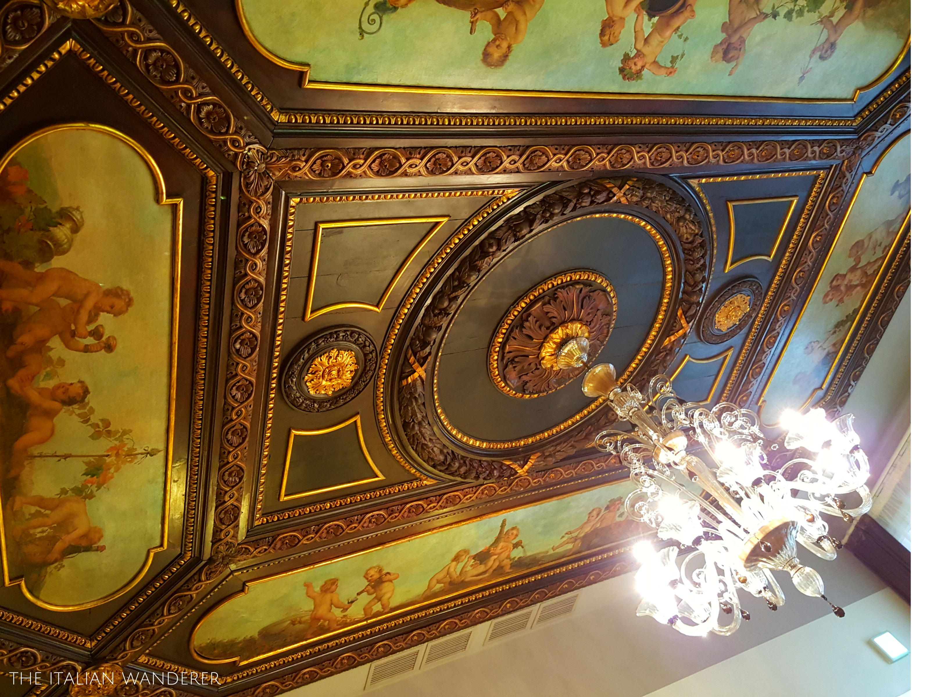 The chandelier and ceiling detail of the breakfast room of Palazzo Barocci, #Venice
