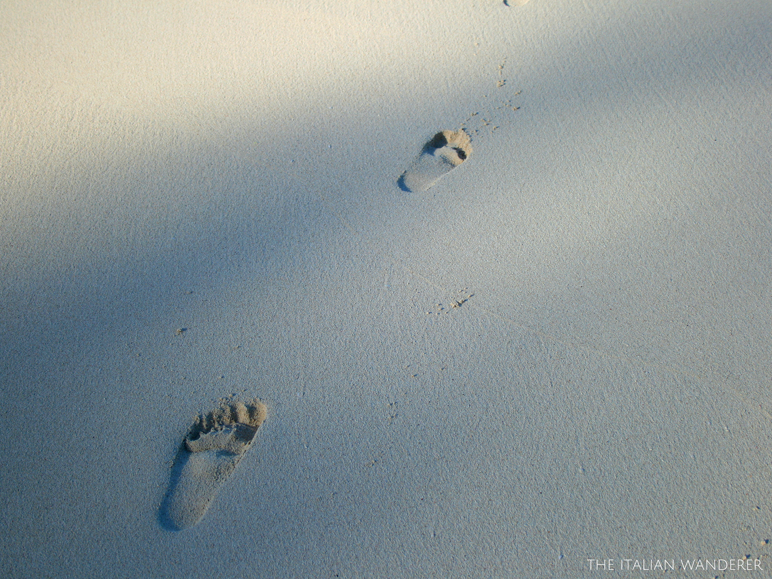 Nassau - footprints on the sand